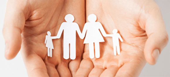 hands-holding-paper-cutout-of-family